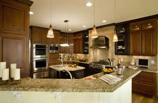Kitchen of an NC custom home withmarble top counters and hanging lighting